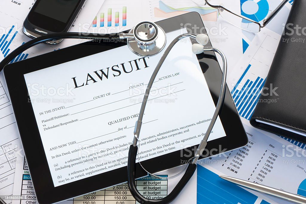 Lawsuit form with a stethoscope stock photo
