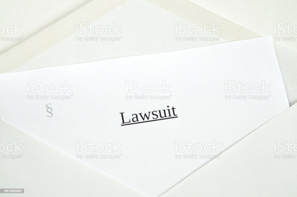 Lawsuit printed on white paper and envelope, white background stock photo