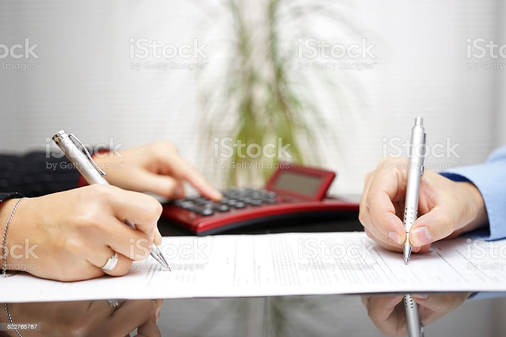 lawyer and client completing contract and prices stock photo