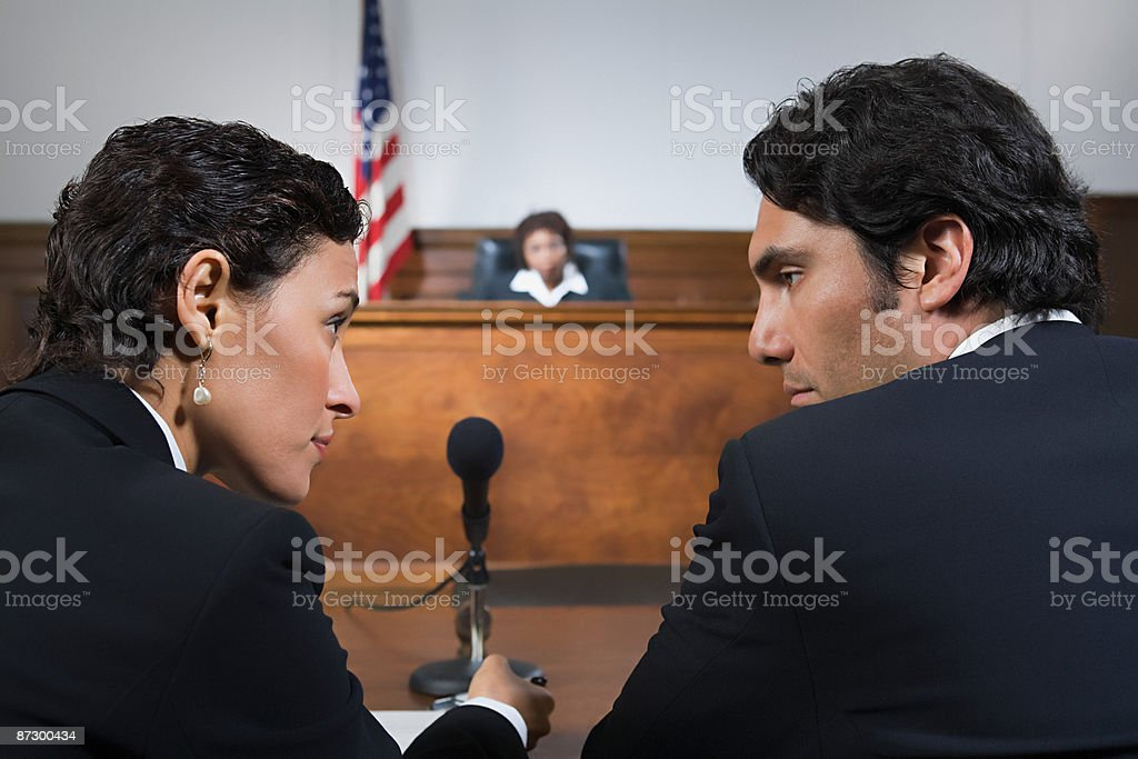 A lawyer and defendant talking stock photo
