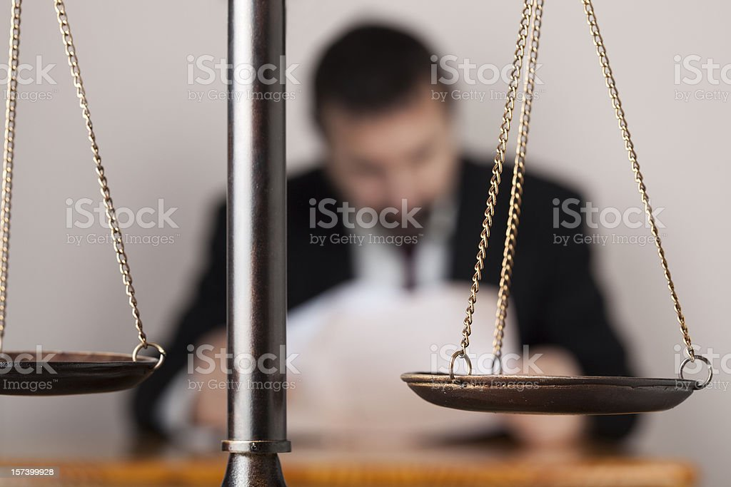 Lawyer behind scale of justice royalty-free stock photo