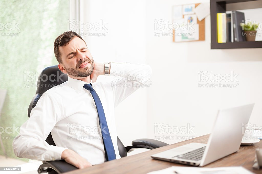 Lawyer dealing with neck pain in an office stock photo