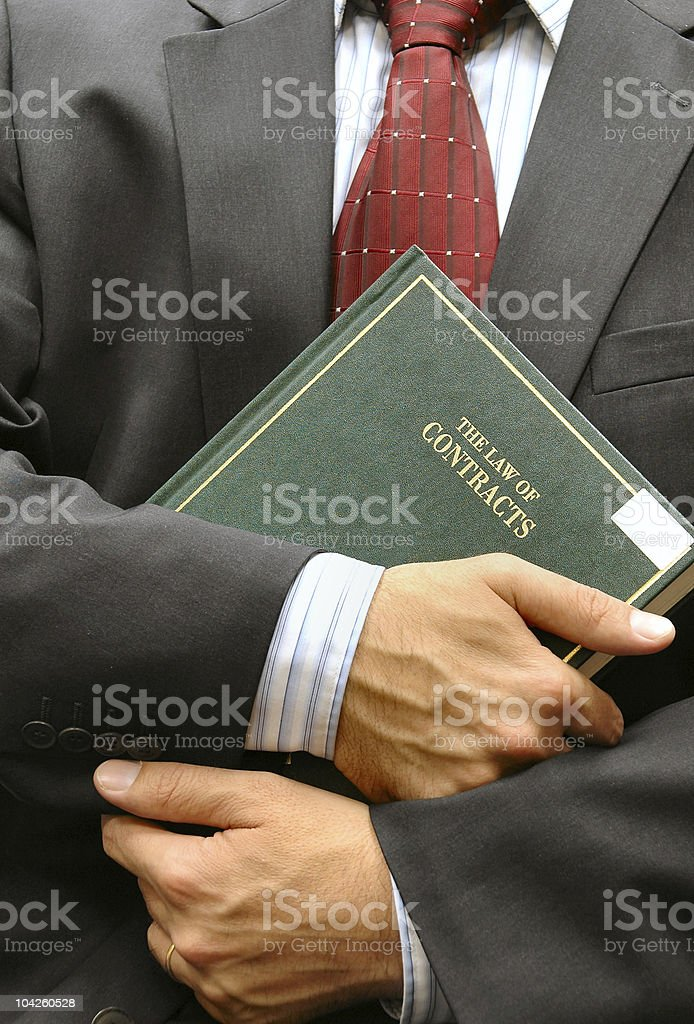 lawyer holding a book stock photo