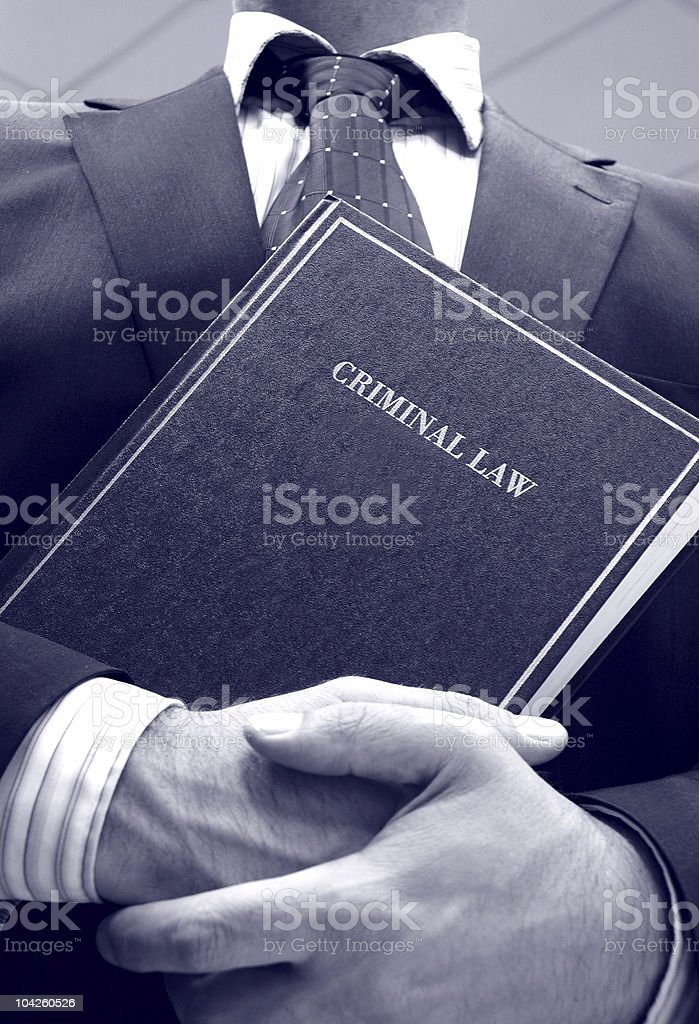 lawyer holding criminal law book stock photo