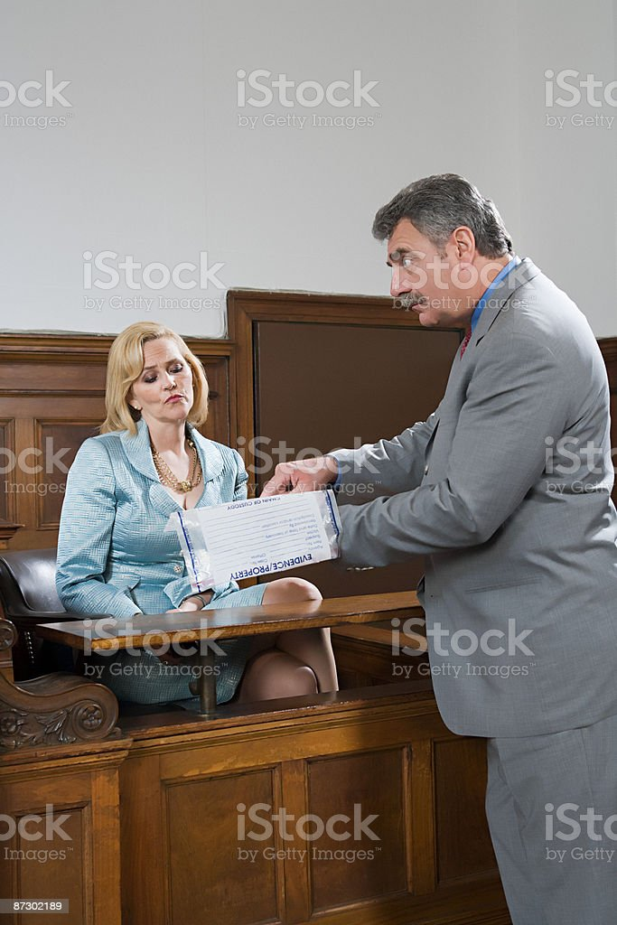 A lawyer questioning a suspect stock photo