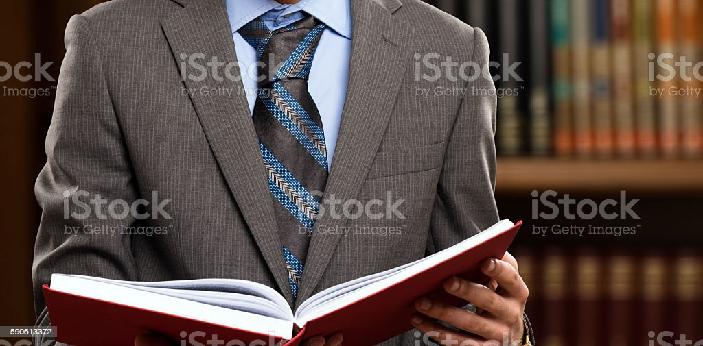 Lawyer reading a book stock photo