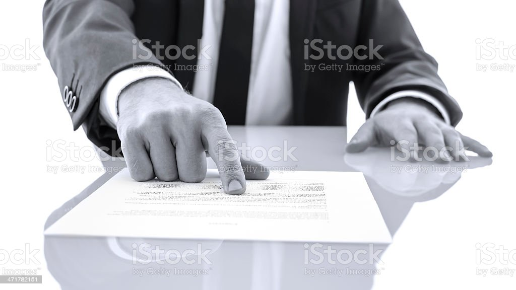 Lawyer showing client to proof read a statement royalty-free stock photo