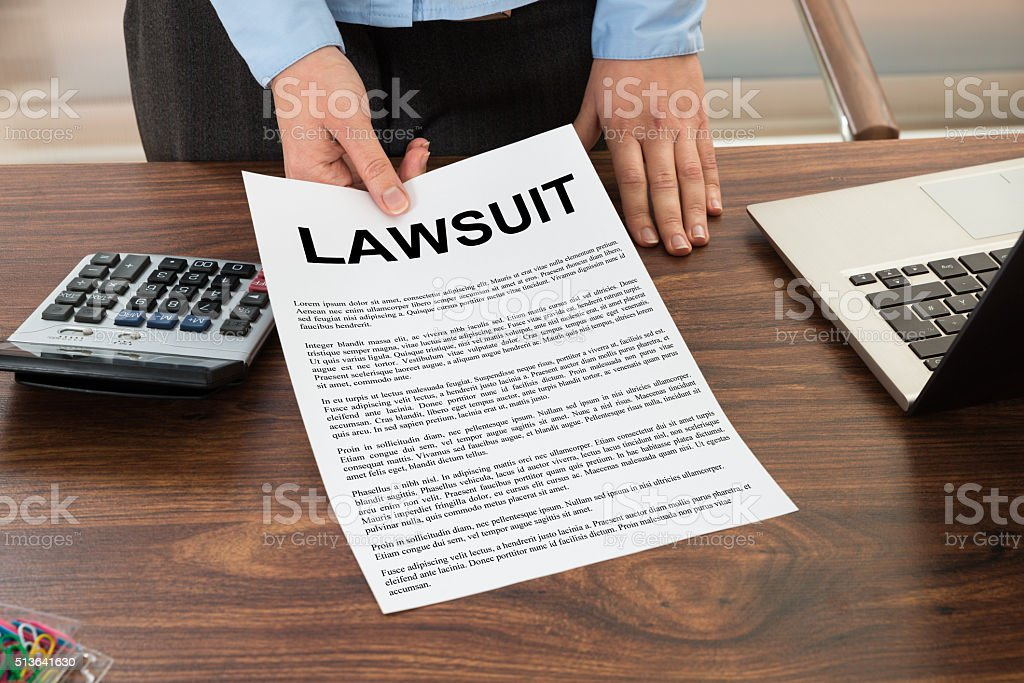 Lawyer Showing The Lawsuit Document stock photo