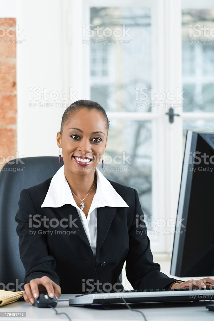 Lawyer sitting in office while working on the computer royalty-free stock photo