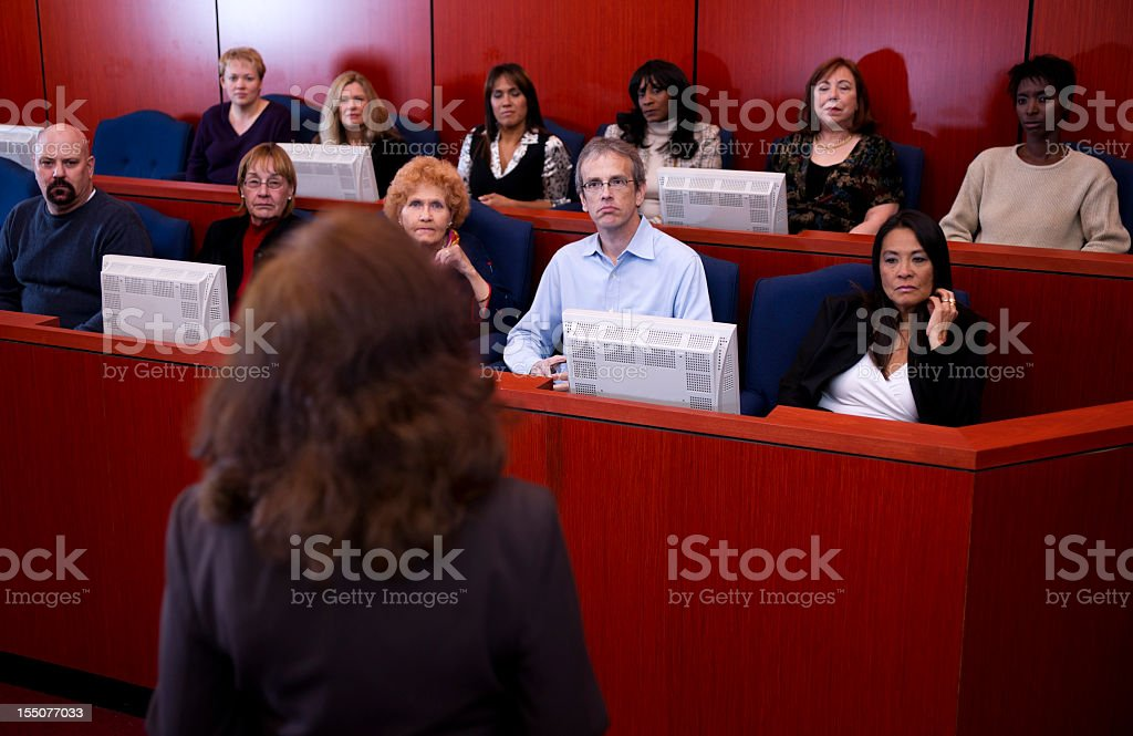 A lawyer speaking to a jury of people stock photo