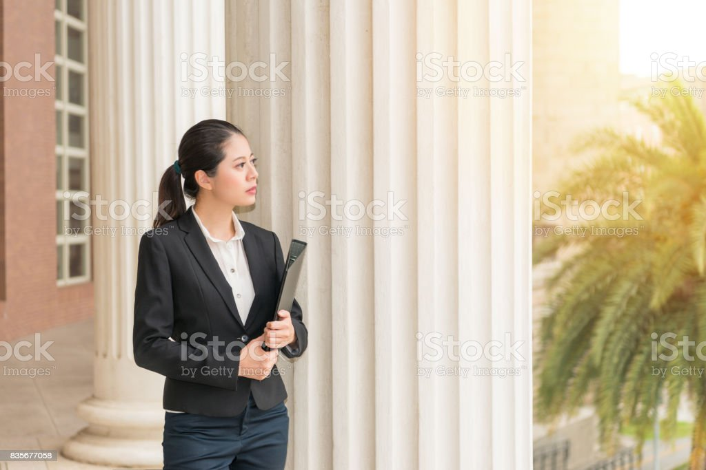 lawyer standing on the classical court building stock photo