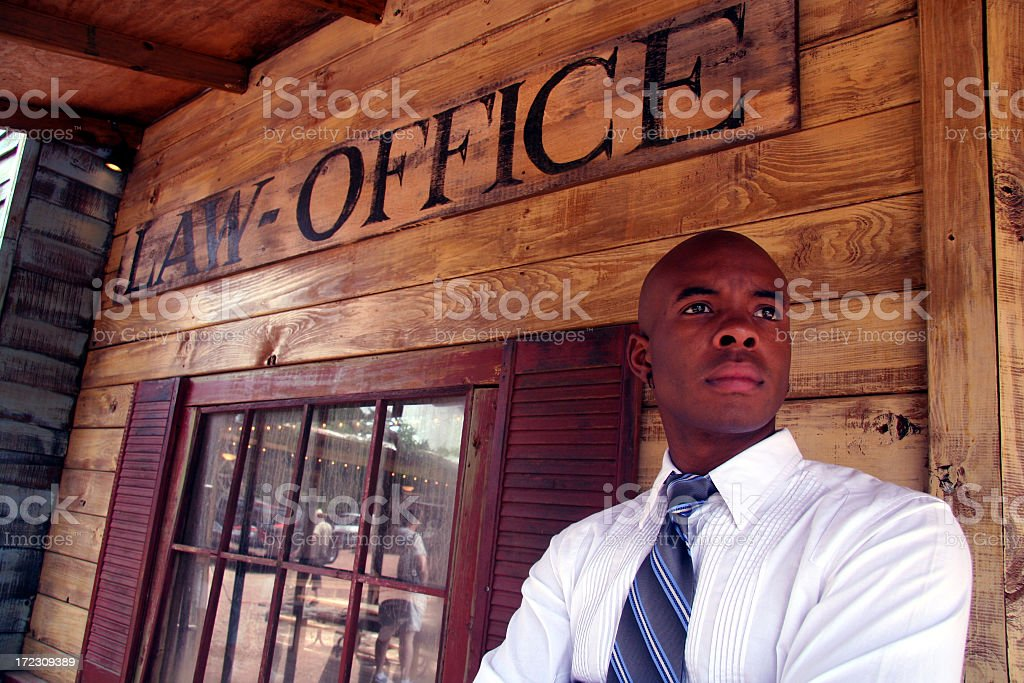 Lawyer Standing Outside Old Rustic Law Office stock photo