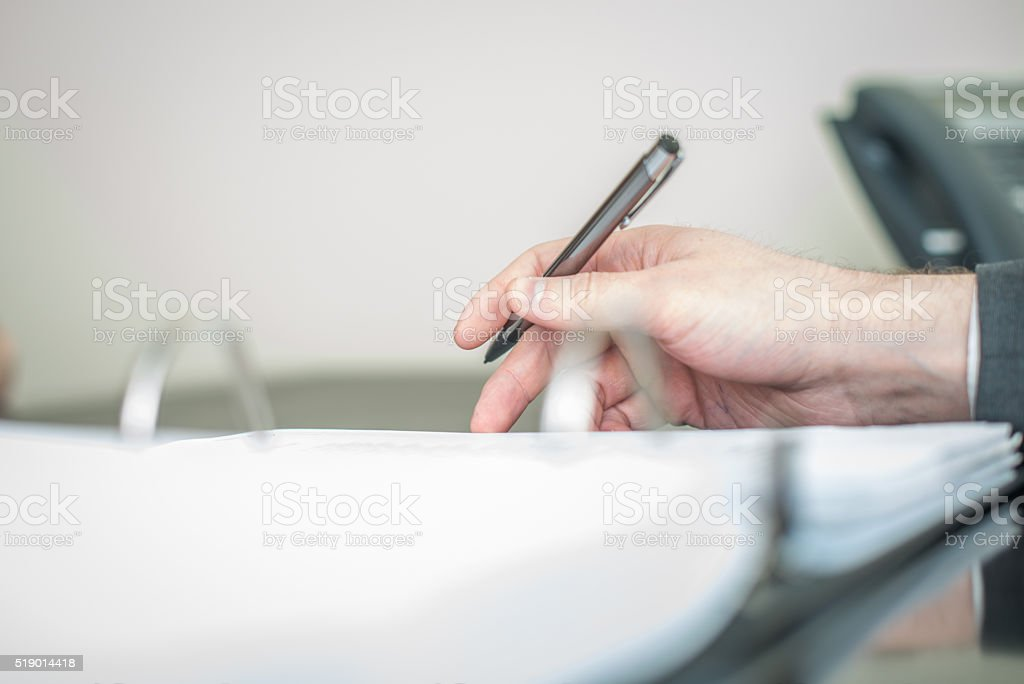 lawyer taking notes business notary stock photo
