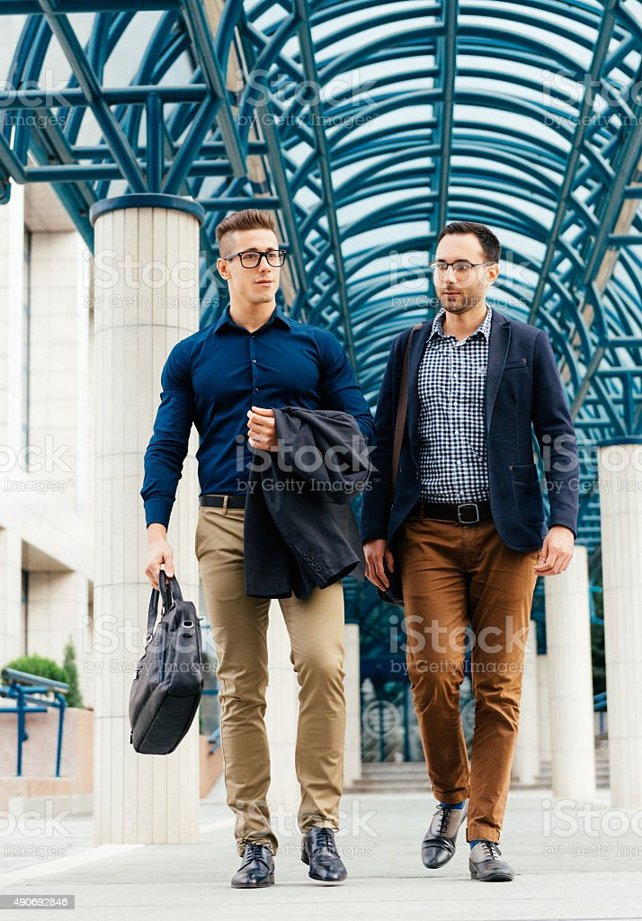 Lawyers after successful court lawsuit in modern lawyer building stock photo