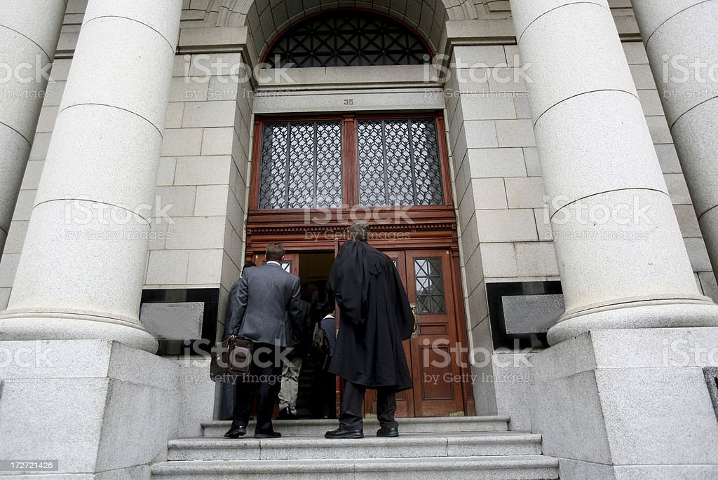 Lawyers and judges on the court steps stock photo