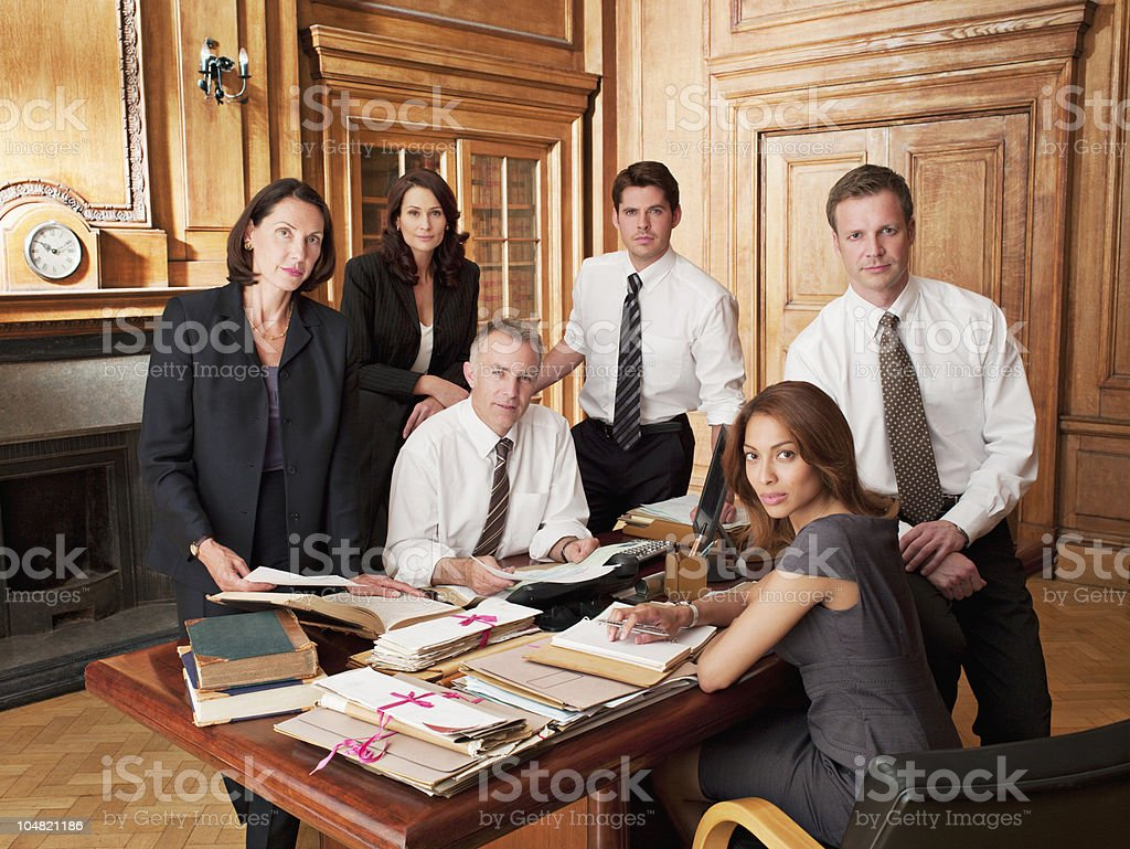 Lawyers around desk in office royalty-free stock photo
