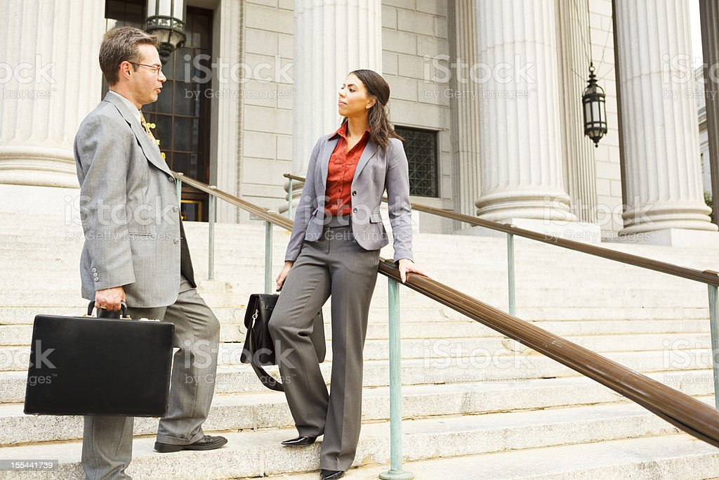 Lawyers in Discussion on Steps stock photo
