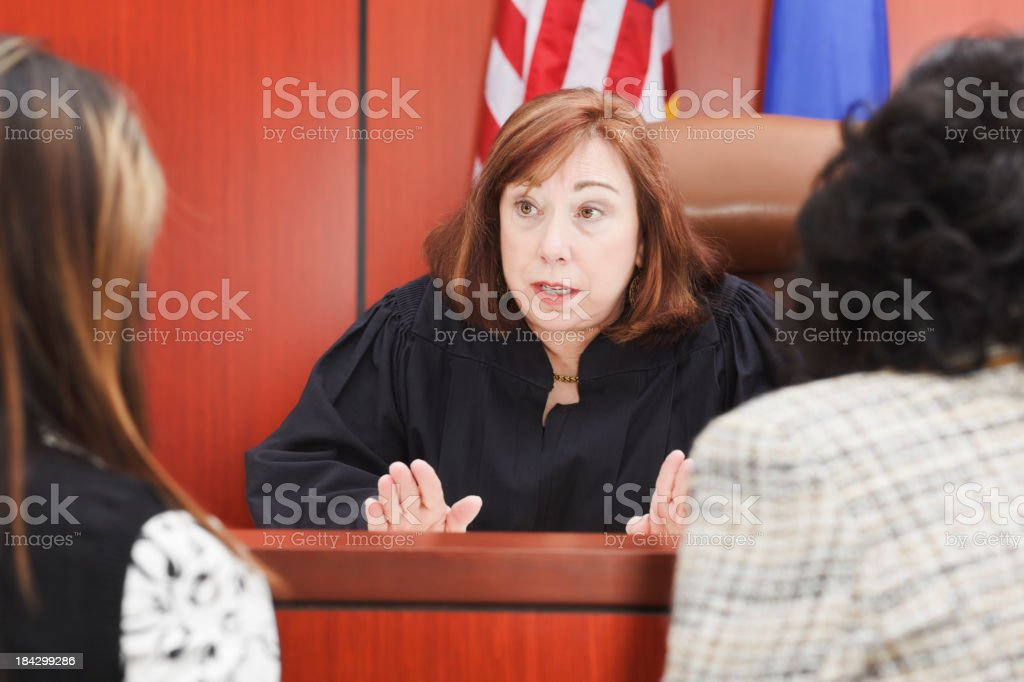 Lawyers Speaking With Judge in Courtroom stock photo