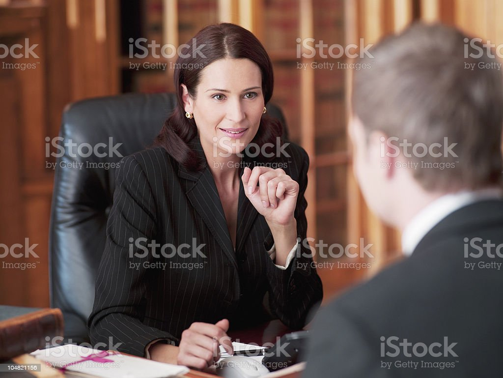 Lawyers talking in office stock photo