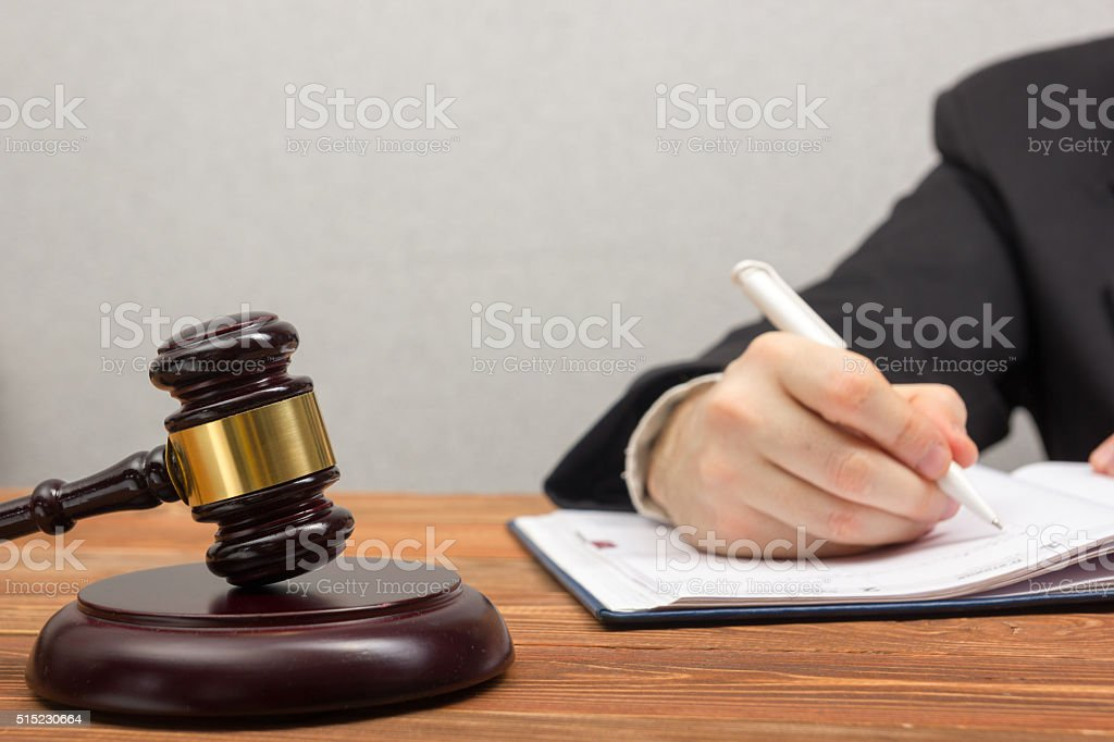 Lawyew working. Notary public signing document at his workplace stock photo