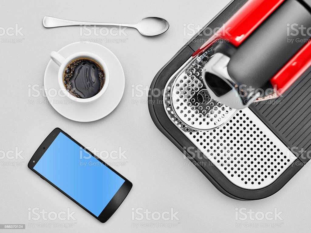 Lay flat expresso and phone. stock photo