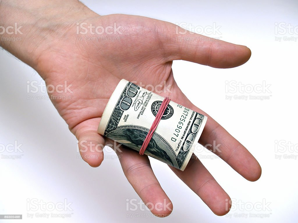 Layer Hundred Dollars in Hand stock photo