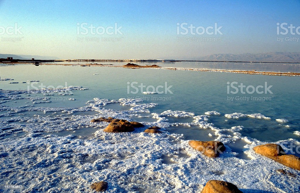 Layer of salt on the Dead Sea in Israel stock photo