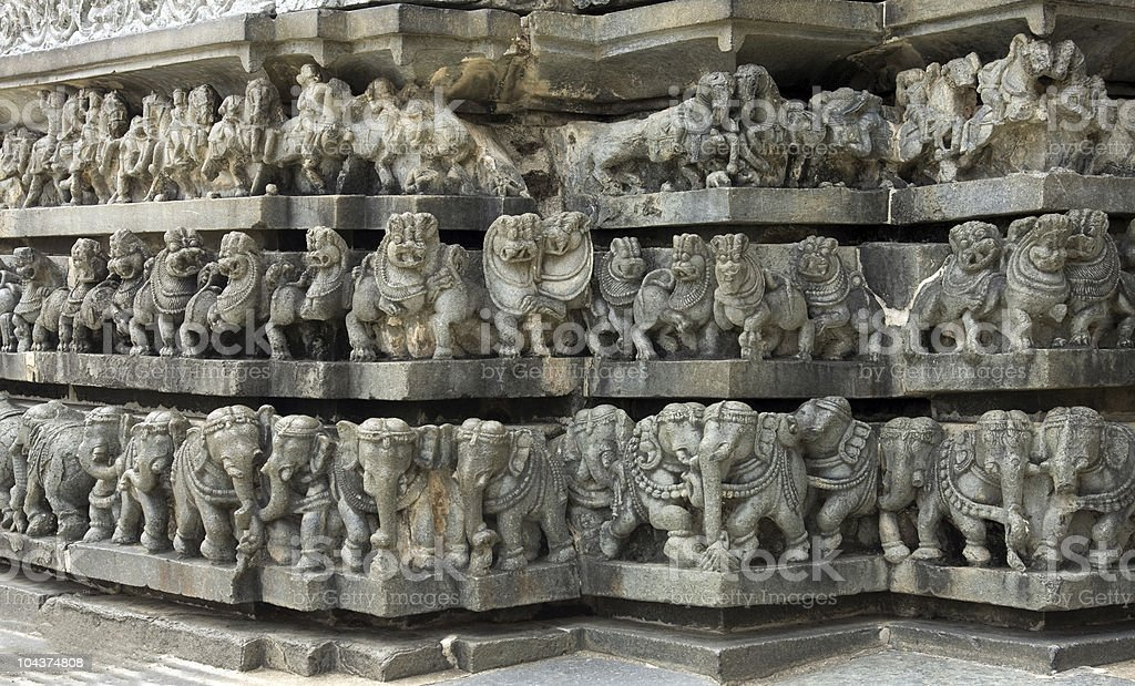 layered ancient carvings of animals in ruins royalty-free stock photo