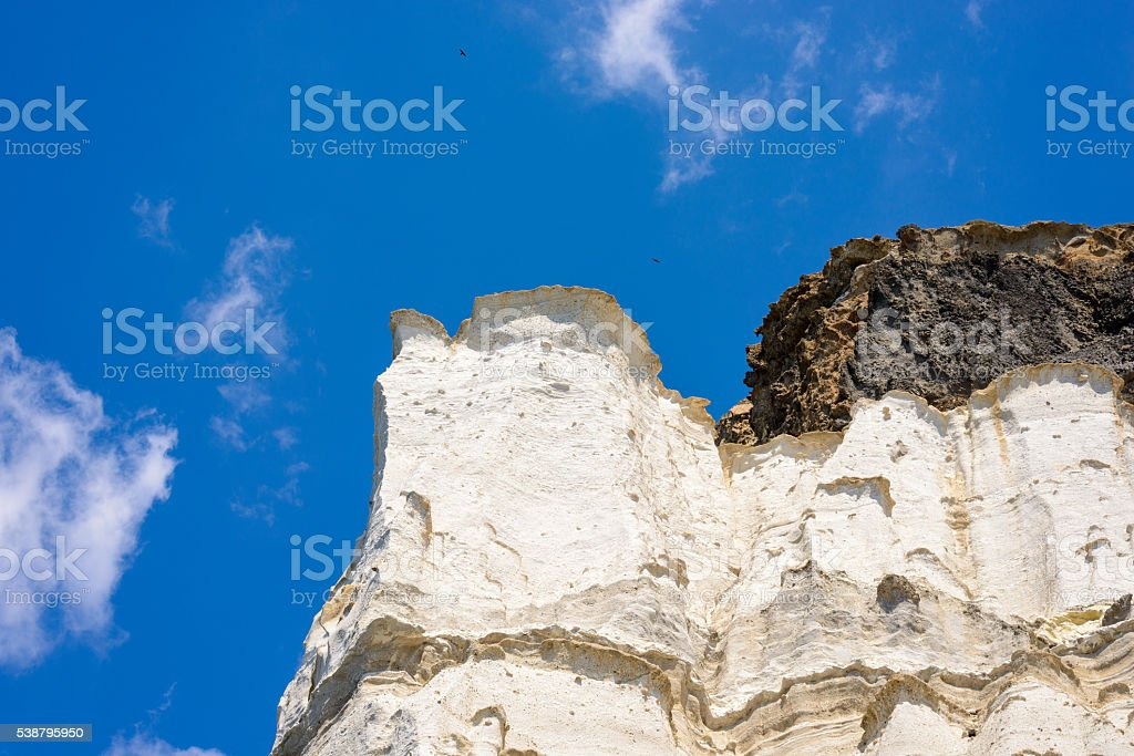 Layered ash deposit rock formations, Melos, Greece stock photo