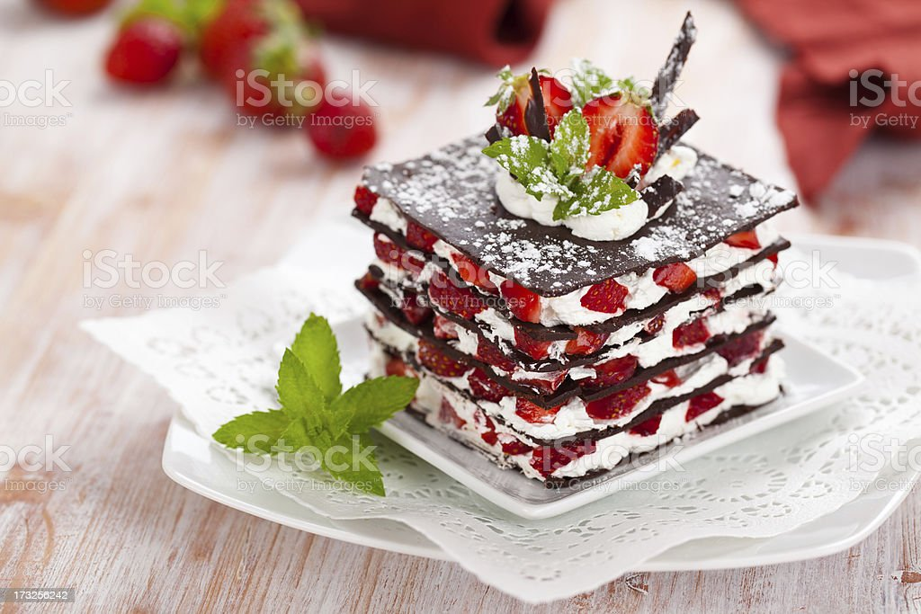 A layered desert with strawberries, cream and chocolate stock photo