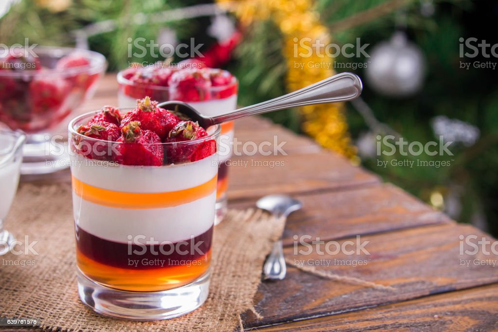Layered jelly dessert with strawberries stock photo