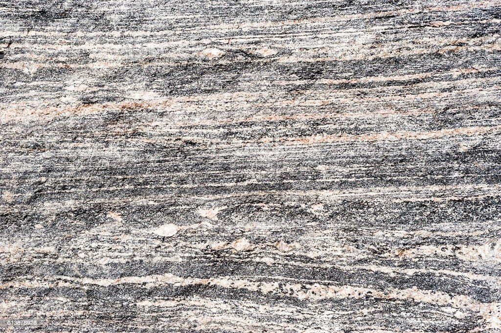 Layered metamorphic rock background texture. stock photo