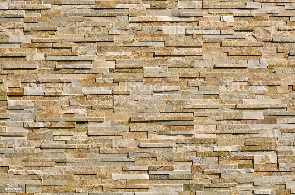 Layered Multi Colored Stone Brick Background stock photo