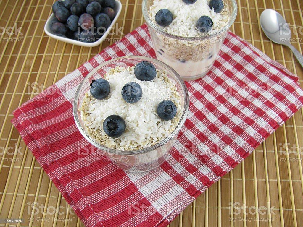Layered oat muesli with blueberries stock photo
