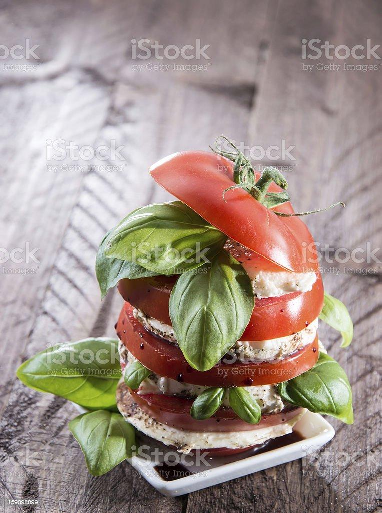 Layered slices of Tomato and Mozzarella royalty-free stock photo