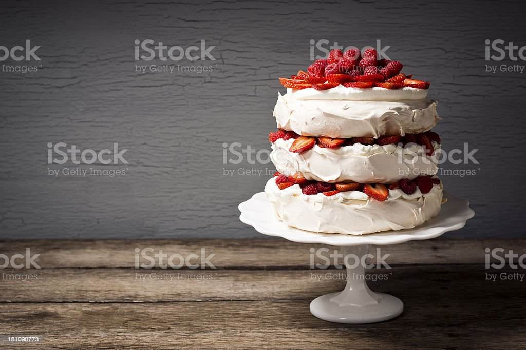 Layered Strawberry and Raspberry Pavlova with Copy Space stock photo