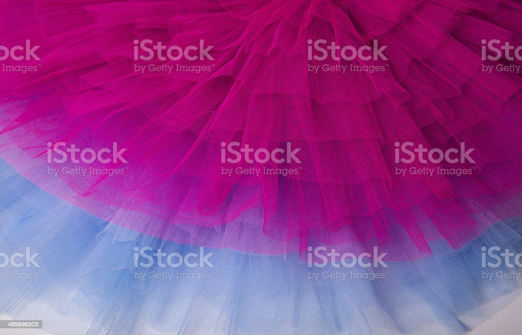 Layers of neon pink and blue tulle stock photo