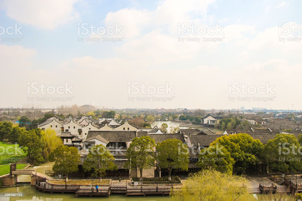 Layers of tile roofs in the blue sky stock photo