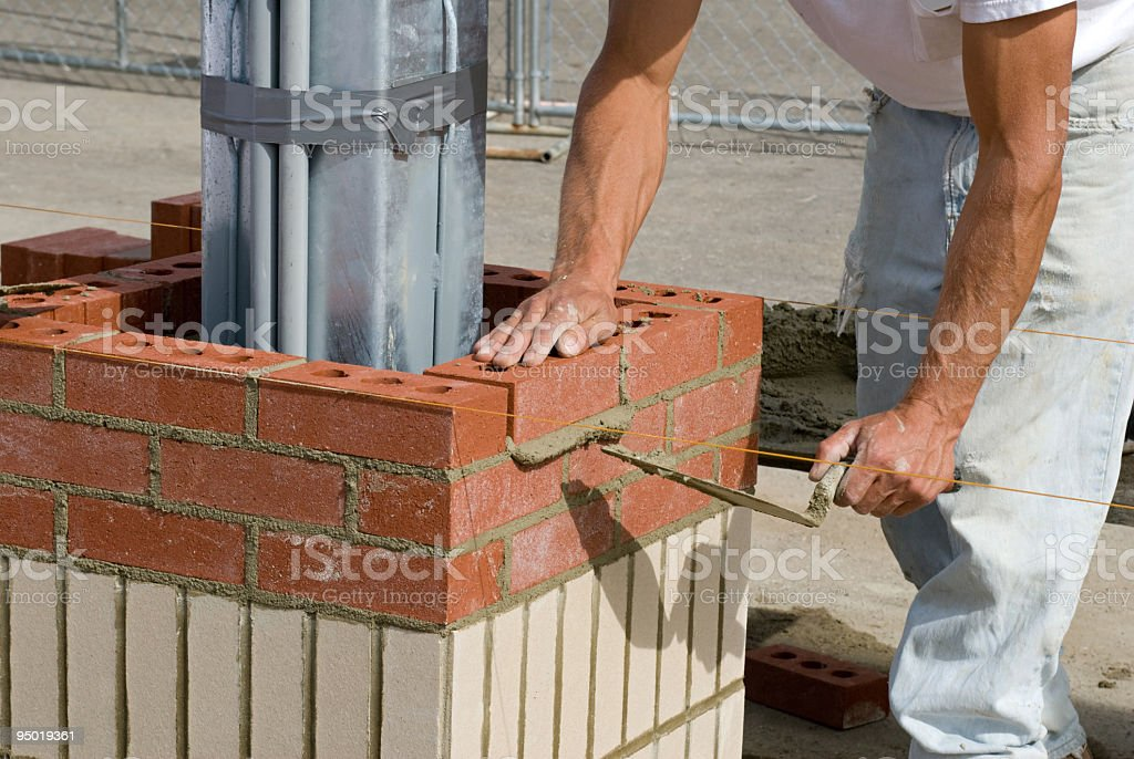 Laying Brick stock photo