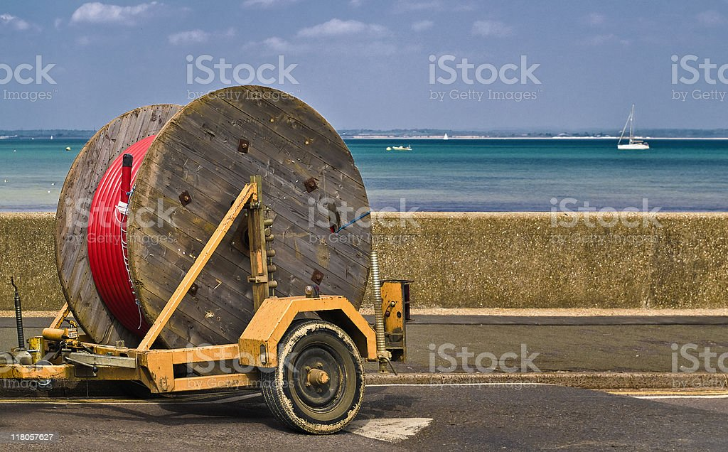 Laying cables - Big reel for internet fibre optics cable royalty-free stock photo