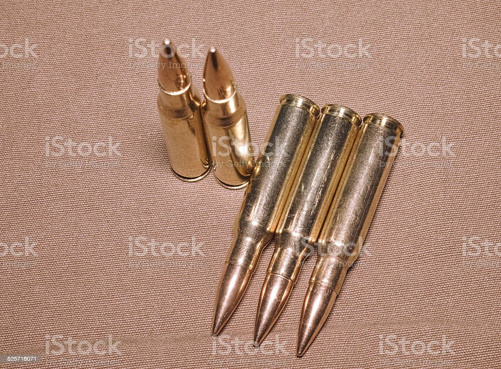 laying cartriges 308 caliber with full metal jacket bullets stock photo