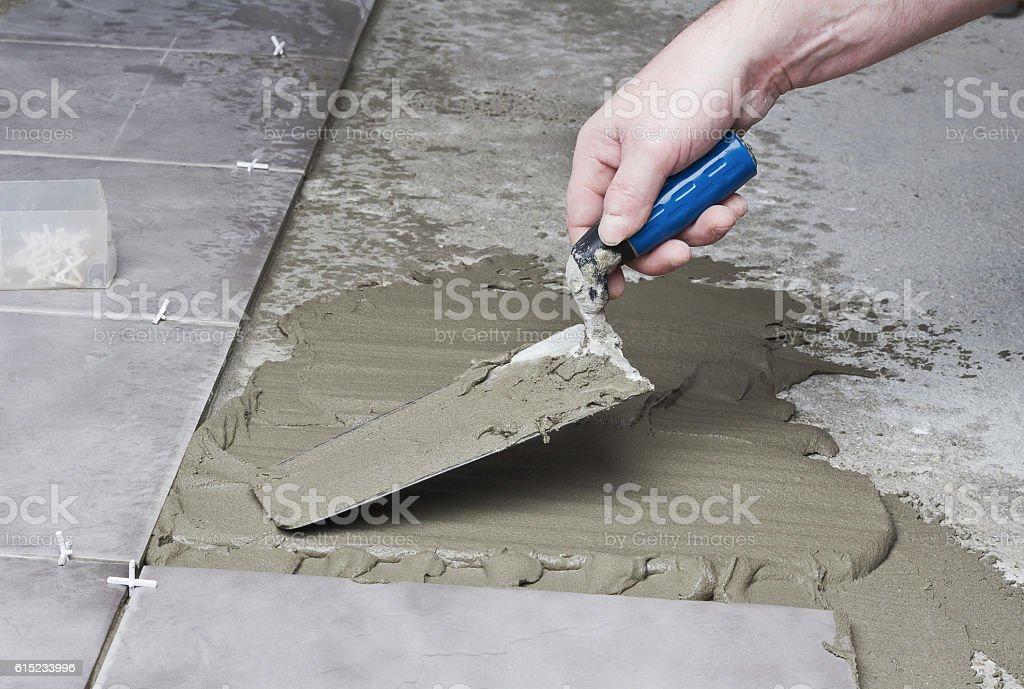 Laying ceramic tiles. stock photo