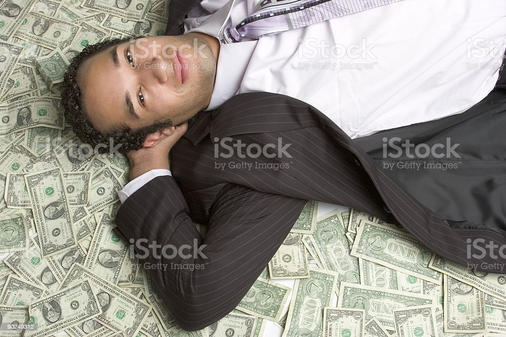 Laying in money royalty-free stock photo