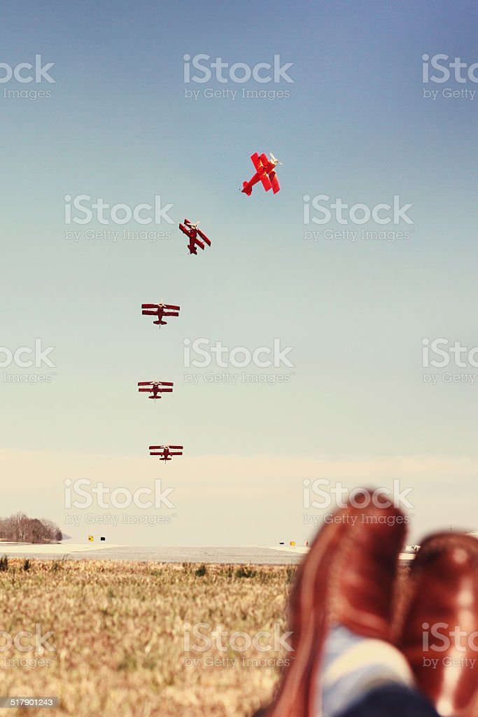 Laying in the grass watching people fly stock photo