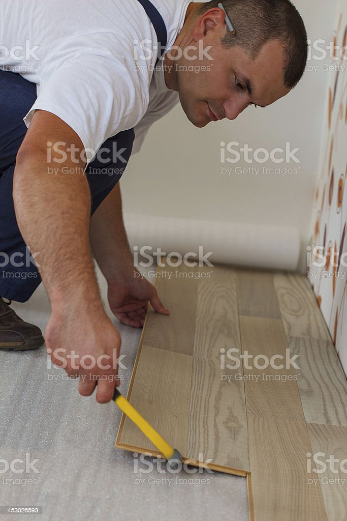 Laying laminate flooring in a home. royalty-free stock photo