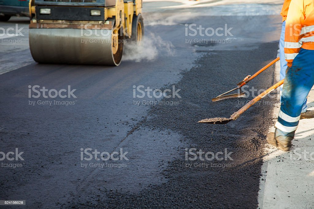 Laying new layer of asphalt stock photo