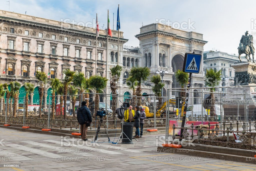 Laying of palm trees in Duomo square (Cathedral Square), opposite the cathedral (Duomo) of Milan, Milan, Italy stock photo