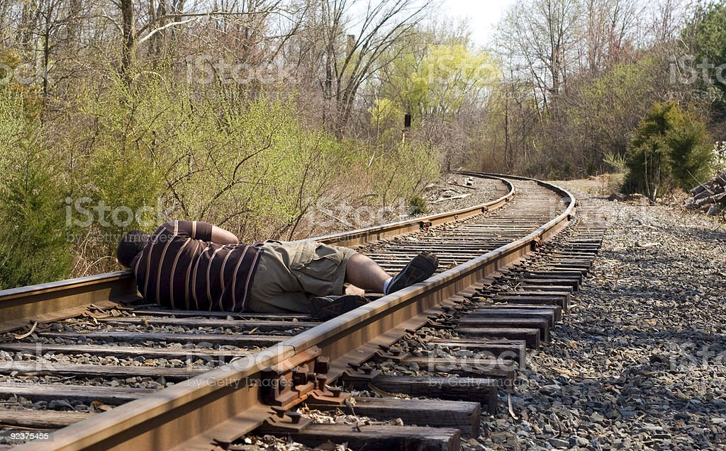 Laying on the Rails stock photo