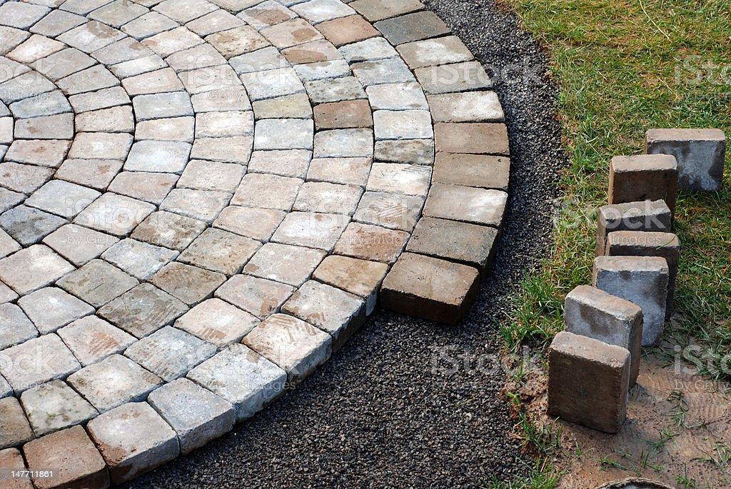Laying patio bricks stock photo