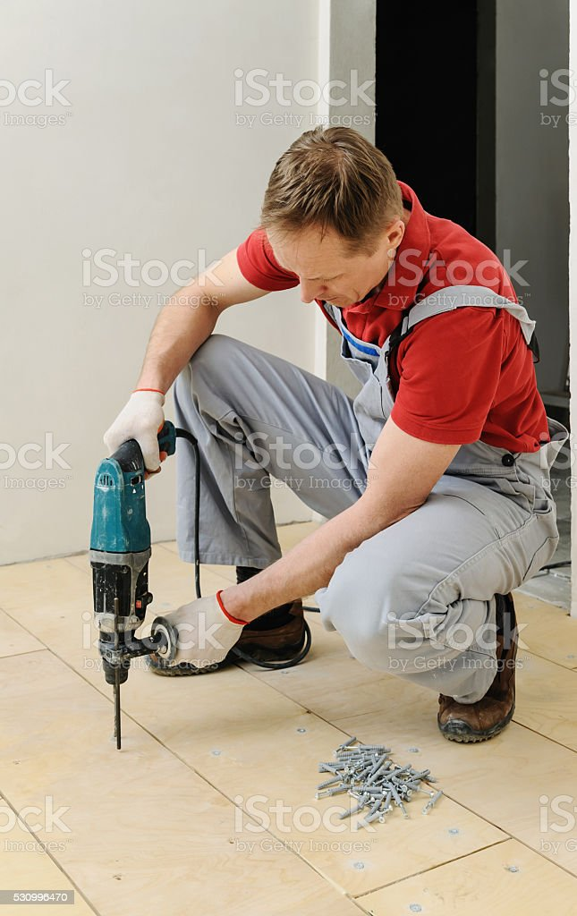 Laying plywood on the floor. stock photo